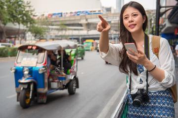 woman traveller standing beside the street
