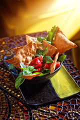 delicious salad with nachos and vegetables