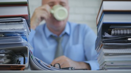 Blurred Image With Businessman In Accounting Archive Drinking Coffee