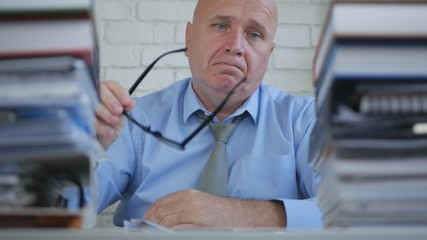 Upset and Amazed Businessman In Blurred Image Working In Accounting Office