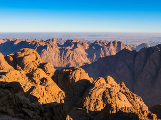 Spectacular aerial view of the holy summit of Mount Sinai, Aka Jebel Musa, 2285 meters, at sunrise, Sinai Peninsula in Egypt. Spirituality, religion and history concept.