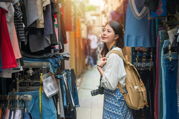 female tourist shopping in the street with camera