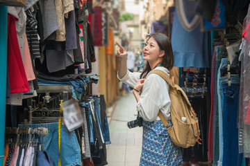 female tourist shopping in the street