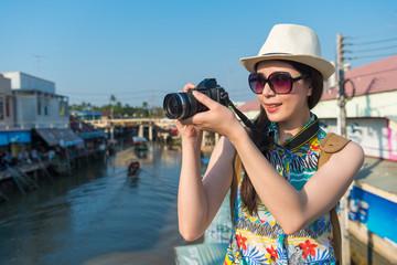 woman looking at camera and take photo