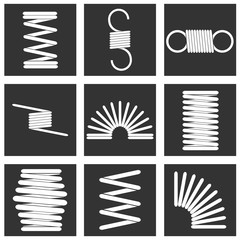 Metal spring, a set of white metal springs against a black background. White spring in a black square.