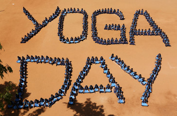 """School children sit as they form the word """"Yoga Day"""" on the International Yoga Day in Chennai"""