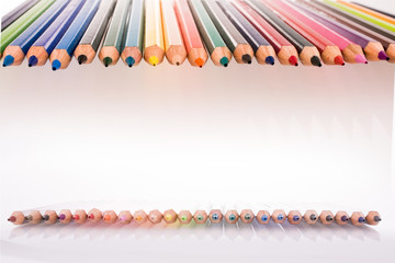 Color pencils of various color on white background