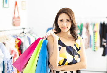 young woman shopping in the clothes store
