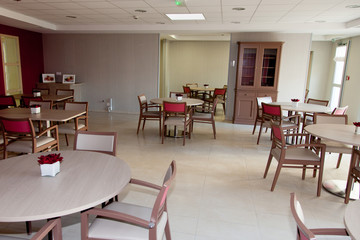 large restaurant room with tables and chairs