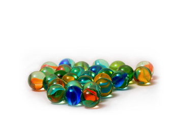 Colored marbles isolated in white background