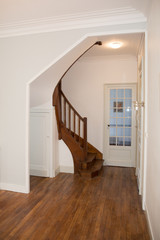 the entrance of the house with a beautiful old staircase