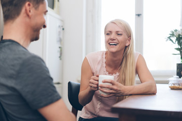 Pretty blond woman laughing at her husband