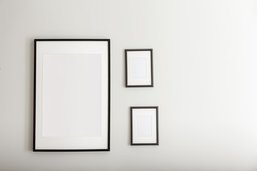 Picture frames on light wall