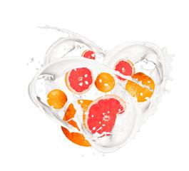 Milk splash with grapefruits isolated on white background.
