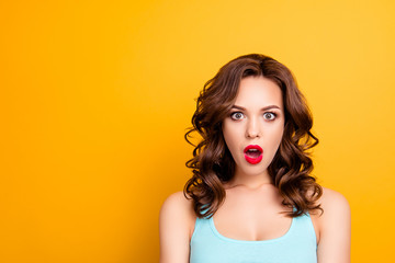 Portrait with copyspace empty place of shocked impressed girl with red pomade lipstick modern hairdo wide open mouth looking at camera isolated on yellow background
