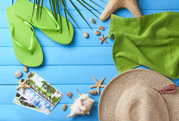Composition with beach accessories on color wooden background