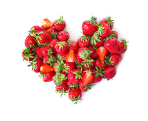 Heart made of ripe red strawberries on white background