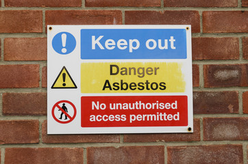 Keep out sign danger asbestos no access permitted UK