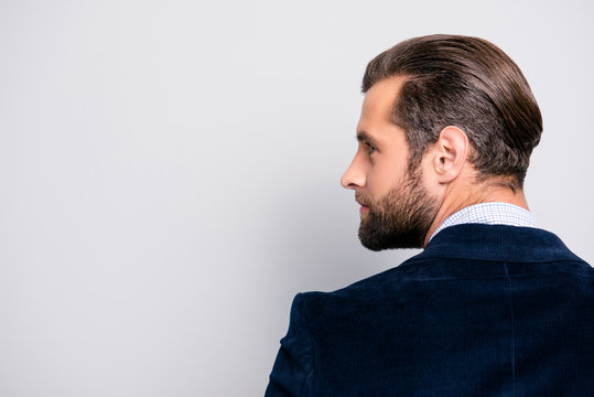 Profile half-faced side view portrait of handsome luxurious attractive stylish modern authoritative dreamy professional elegant entrepreneur, dark blue blazer isolated on gray background copy-space