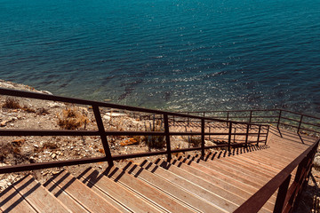 Wooden Stairs to the sea. Vacation Travel Walking Concept