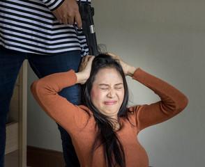 women being strangle by criminal holding shot gun