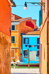Wall Mural - Scenic view of houses by canal in Burano