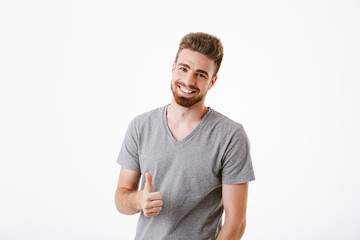 Happy young man make thumbs up gesture.