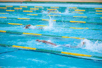 Swimmer swimming competition in the pool is not identifiable