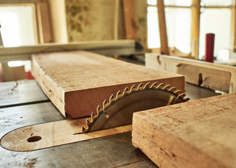 Sawing the board for the subsequent manufacture of the fretboard of a classical guitar.