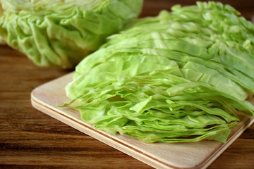 Chopped white cabbage on a wooden board