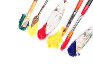 Tools with paints on white background