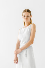 young attractive woman in linen white dress posing isolated on grey background