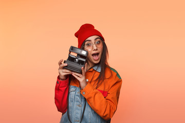 Young woman with retro camera in studio
