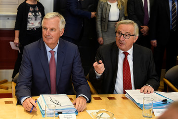 EU Chief Brexit negotiator Michel Barnier sits at a meeting table with European Council President Jean-Claude Juncker at Government buildings in Dublin