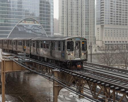 Train entering city in snow
