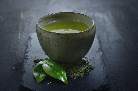 hot green tea in a traditional bowl