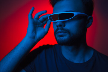 Man in virtual reality glasses in neon light