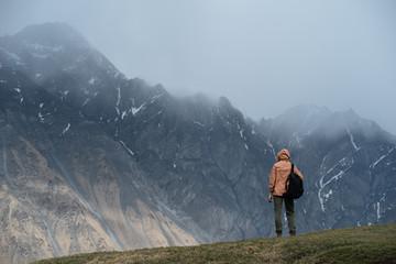 Man looking at mountain tops
