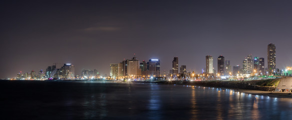Panoramic view of Tel Aviv, city and bay at night. View from promenade of Old City Yafo, Israel