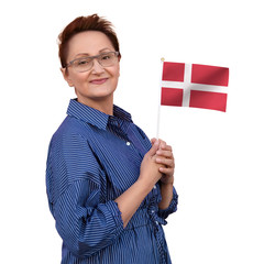 Denmark flag. Woman holding Danish flag. Nice portrait of middle aged lady 40 50 years old with a national flag isolated on white background. Learn Danish language. Visit Denmark concept.
