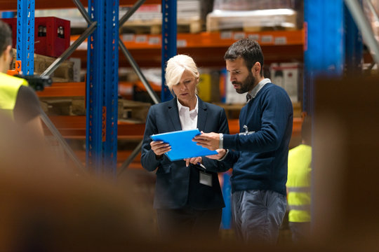 Managers checking inventory in warehouse