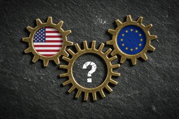 Zahnräder auf Schiefertafel symbolisieren Ungewissheit zwischen USA und EU