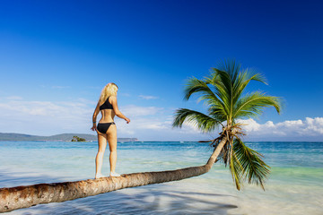 girl making steps on the palm tree