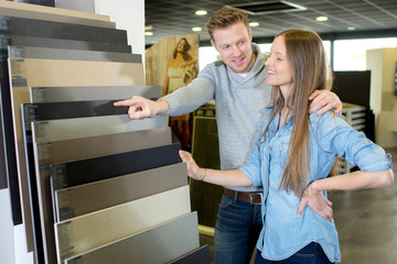 couple having choosing for buying tiles