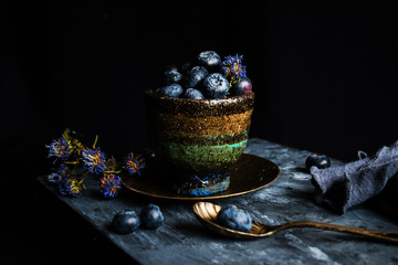 Handmade cup with blueberries.