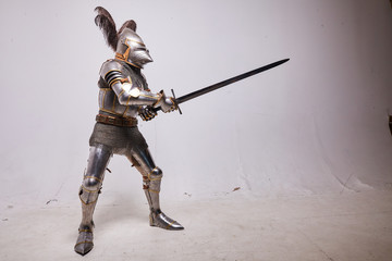 Knight in armor on white background