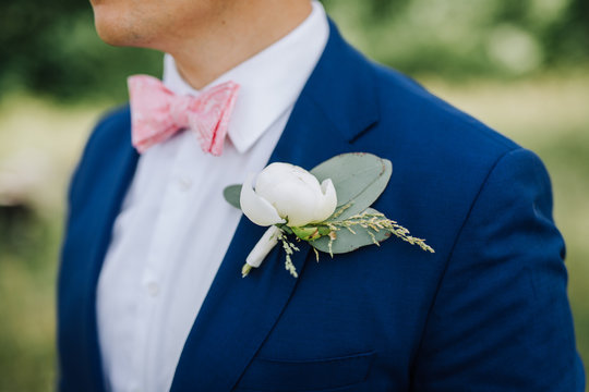 Groom bow tie, flower and shirt close up