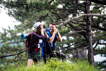 Happy couple hiking outdoors in forest
