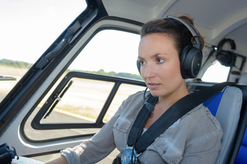 close up portrait of young woman helicopter pilot