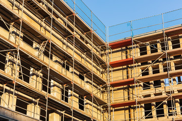 building construction site with scaffolds